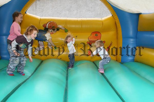 Kids having fun on the bouncy castle, 07W37N58