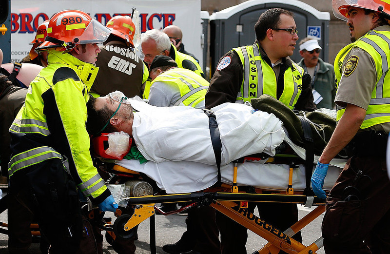 . A man is loaded into an ambulance after he was injured by one of two bombs exploded during the 117th Boston Marathon near Copley Square on April 15, 2013 in Boston, Massachusetts. Two people are confirmed dead and at least 23 injured after two explosions went off near the finish line to the marathon.  (Photo by Jim Rogash/Getty Images)