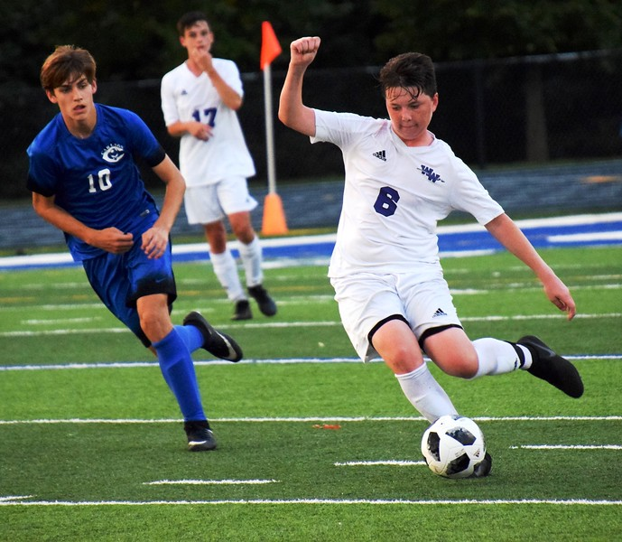 Woodhaven's Josh Vernier (6) gets ready to take a shot on Wednesday night, followed by Cameron Briggs of host Gibraltar Carlson. Vernier and the first-place Warriors held on for a 3-2 victory in what was the final game of the first half of the Downriver League season. Alex Muller - For Digital First Media