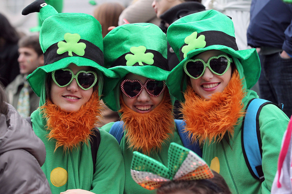 . Spectators dressed as leprechauns attend St Patrick\'s Day parade in Dublin on March 17, 2014. More than 100 parades are being held across Ireland to mark St Patrick\'s Day, the feast day of the patron saint of Ireland, with up to 650,000 spectators expected to attend the parade in Dublin. AFP PHOTO/ PETER  MUHLY/AFP/Getty Images