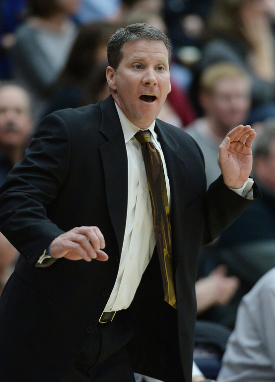 . LITTLETON, CO. - JANUARY 17: Chatfield coach Stephen Schimpeler watched the action from the bench in the first half. The Dakota Ridge High School boy\'s basketball team hosted Chatfield Friday night, January 16, 2014. Photo By Karl Gehring/The Denver Post