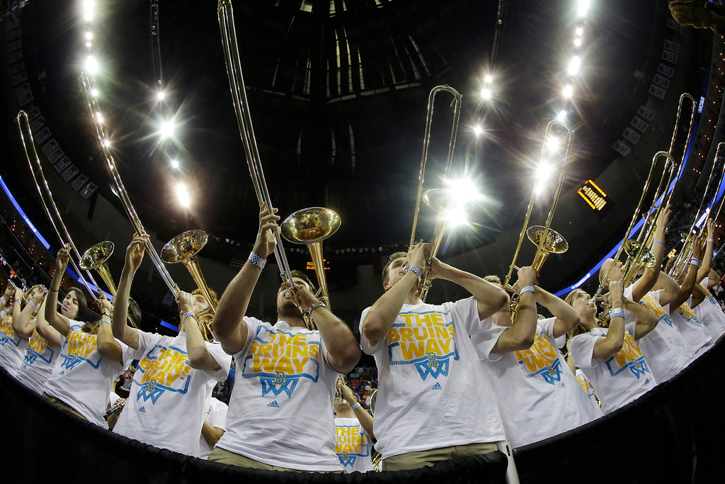 . The UCLA pep band performs before the first half in a regional semifinal game against Florida at the NCAA college basketball tournament, Thursday, March 27, 2014, in Memphis, Tenn. Dayton won 82-72. (AP Photo/Mark Humphrey)