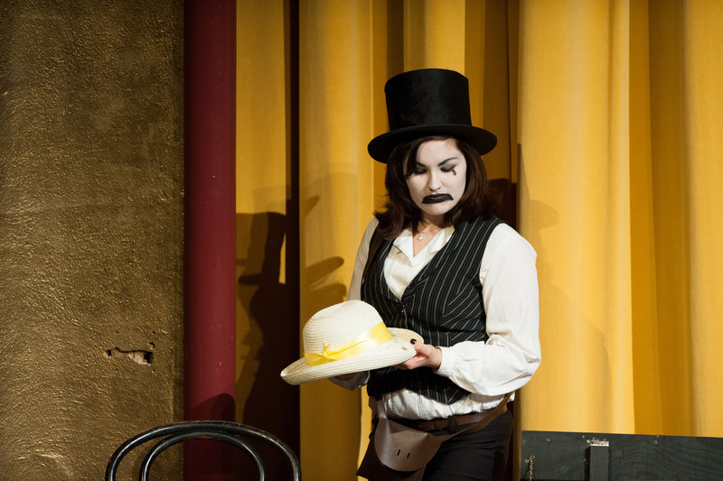 Act I is underway. Emily Post, painted as theatre sad, is the mute (Mime).