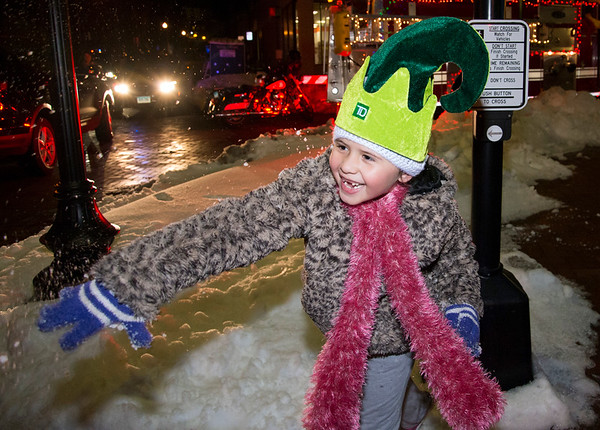 12/05/19 Wesley Bunnell | StaffrrThe New Britain Christmas tree was lit on Thursday night in Central Park complete with a visit from Santa Clause who rode in on a NBFD fire truck. Seven year old Arabella Devevo throws a snow ball at her father Jesus Rivera.