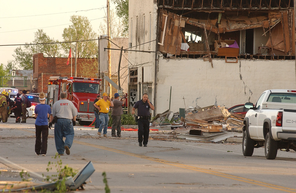 . First responders, volunteers and firemen gather on Main Street in Quapaw, Okla. after a tornado struck the city on Sunday evening, April 27, 2014.    A powerful storm system rumbled through the central and southern United States on Sunday, spawning a massive tornado that carved path of destruction through the northern Little Rock suburbs and another twister that killed two people in Oklahoma and injured others in Kansas. (AP Photo/Tulsa World,  Gary Crow)
