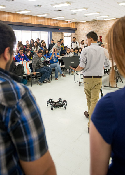 """Joshua Nguyen gives a demonstration of the """"Spider"""" project at Martin Middle School, during TAMU-CC's iCore visit."""