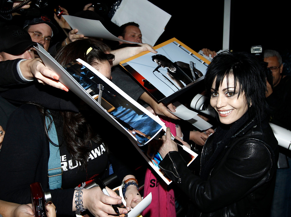 """. Musician Joan Jett signs autographs for fans at the premiere of \""""The Runaways\"""" in Los Angeles on Thursday, March 11, 2010. (AP Photo/Matt Sayles)"""