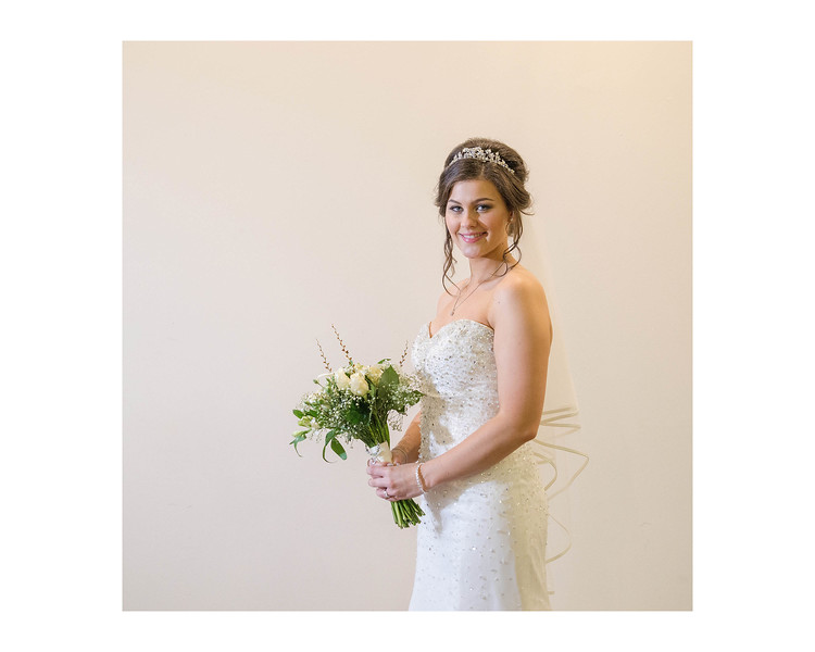 Wedding Photography of Kirstin & Kyle, Dean Park Hotel, Kirkcaldy, Fife, Scotland, Photograph is of the Bride standing in a classic style holding her bouquet