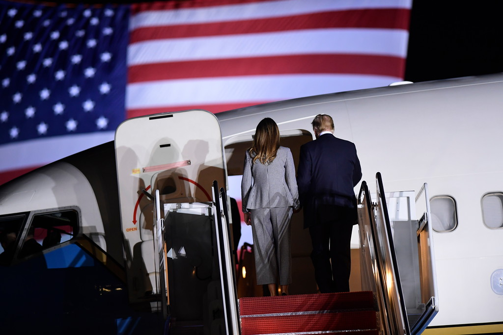 . President Donald Trump and first lady Melania Trump stand on the steps of a U.S. military plane carrying three Americans freed from captivity in North Korea, to greet them upon their arrival at Andrews Air Force Base in Md., Thursday, May 10, 2018. (AP Photo/Susan Walsh)