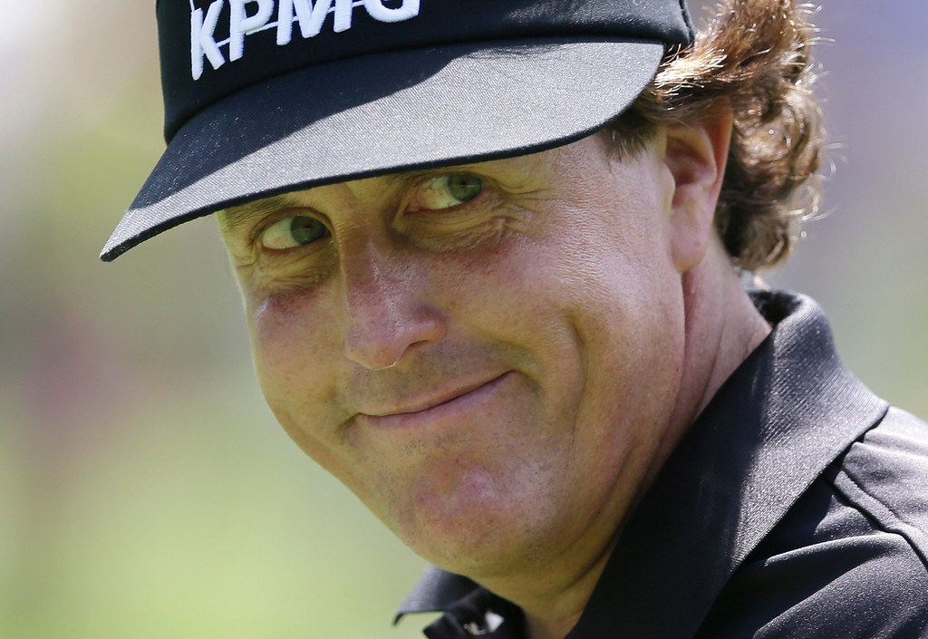 . Phil Mickelson smiles his he walks to the 10th green during the third round of the PGA Championship golf tournament at Oak Hill Country Club, Saturday, Aug. 10, 2013, in Pittsford, N.Y. (AP Photo/Patrick Semansky)