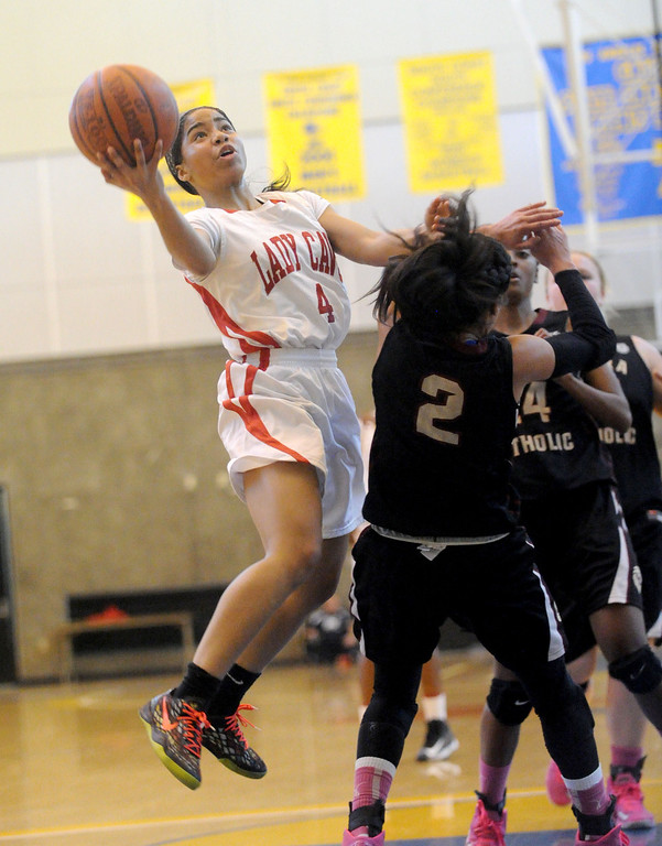 . 03-12-2013--(LANG Staff Photo by Sean Hiller)-Serra\'s Deandrea Toler (4) battles JSerra\'s August Touchard (2) in Tuesday\'s girls basketball IV Southern California Regional semifinal at L.A. Southwest College.