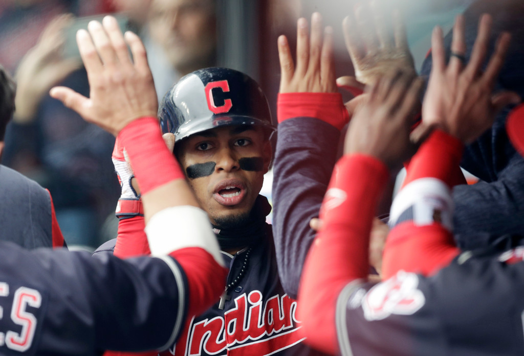 . Cleveland Indians\' Francisco Lindor is congratulated by teammates after Lindor hit a solo home run off Kansas City Royals starting pitcher Jakob Junis in the third inning of a baseball game, Saturday, May 12, 2018, in Cleveland. (AP Photo/Tony Dejak)