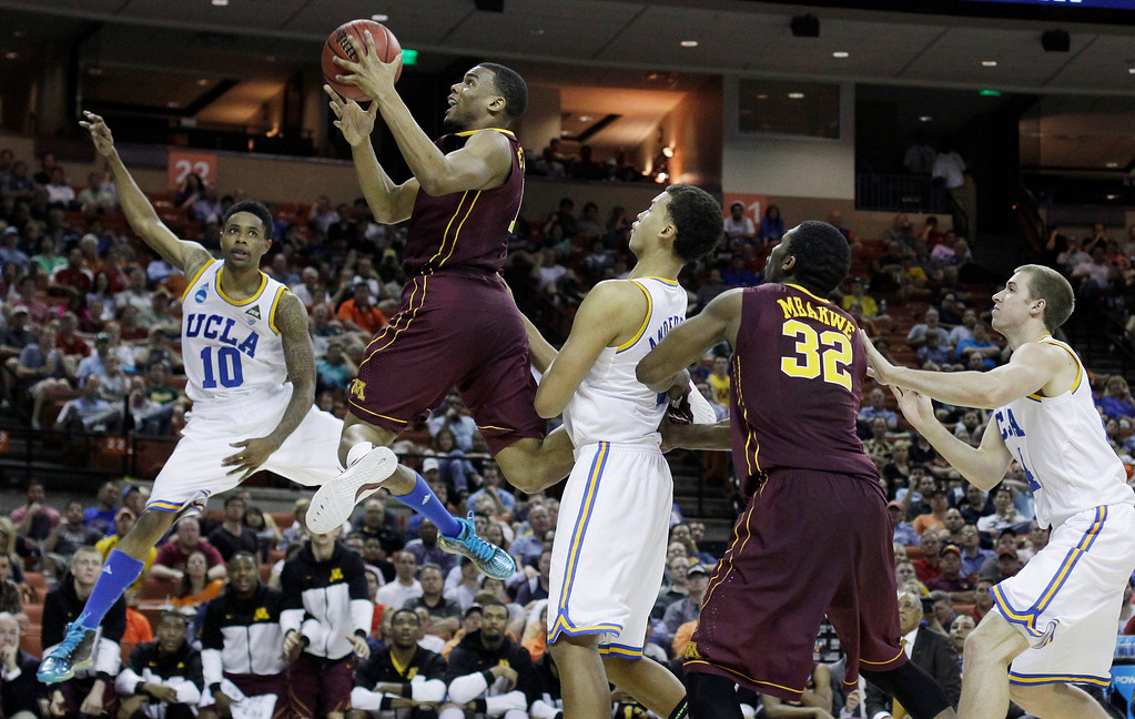 . Minnesota\'s Andre Hollins, second from left, drives against UCLA\'s Larry Drew II (10) during the second half of a second-round game of the NCAA college basketball tournament Friday, March 22, 2013, in Austin, Texas. Minnesota won 83-63. (AP Photo/Eric Gay)