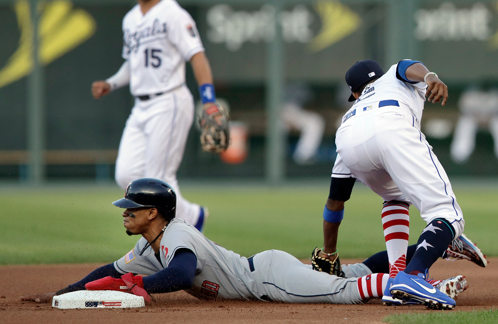 . Cleveland Indians\' Francisco Lindor beats the tag by Kansas City Royals shortstop Alcides Escobar (2) during the first inning of a baseball game at Kauffman Stadium in Kansas City, Mo., Wednesday, July 4, 2018. Lindor was safe with a stolen base. (AP Photo/Orlin Wagner)