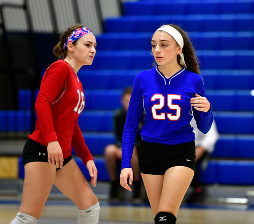 10/11/2019 Mike Orazzi | StaffrSt. Paul's Grace Carabetta (16) and Emily Esposito (25) during Thursday nights girls volleyball with Torrington in Bristol. r