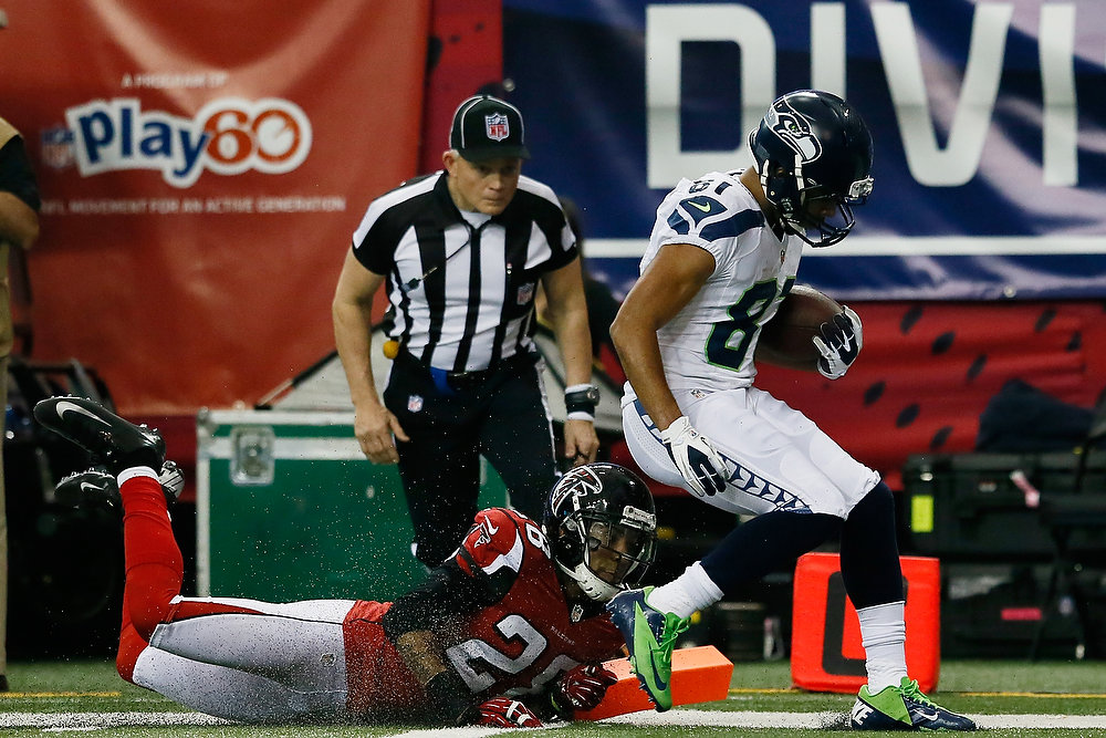 . Golden Tate #81 of the Seattle Seahawks runs a reception in for a third quarter touchdown against the defense of  Thomas DeCoud #28 of the Atlanta Falcons during the NFC Divisional Playoff Game at Georgia Dome on January 13, 2013 in Atlanta, Georgia.  (Photo by Kevin C. Cox/Getty Images)