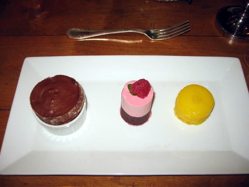 A Trio of Desserts: Hot Bittersweet Chocolate Soufflé, Frozen Raspberry Soufflé, and Lemon Pudding Cake.  Paired with Mas Estela, Grenache, Vi Dolç Natural, Empordà, Spain (solera 1991).