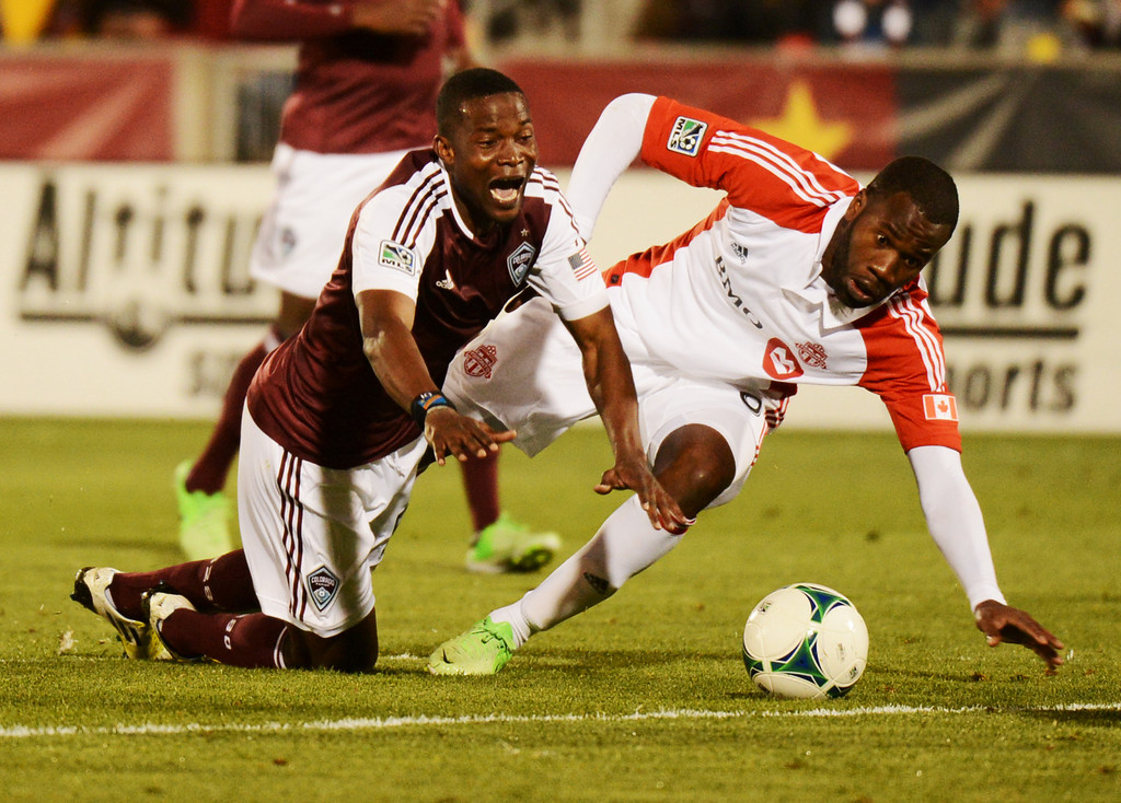 . COMMERCE CITY, CO. - MAY 04 : Danny Mwanga #55 of Colorado Rapids is fouled by Gale Agbossoumonde #6 of Toronto FC at Dick\'s Sporting Goods Park in Commerce City, Colorado. May 4, 2013. Colorado won 1-0. (Photo By Hyoung Chang/The Denver Post)