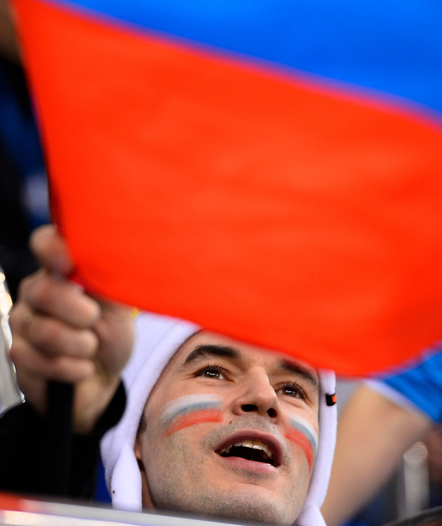 . A fan of Russia waves the Russian flag in the first period during the women\'s match between Russia and Germany at the Shayba Arena in the Ice Hockey tournament at the Sochi 2014 Olympic Games, Sochi, Russia, 09 February 2014.  EPA/LARRY SMITH