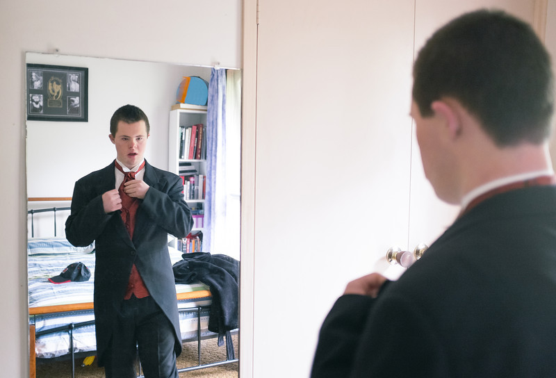 Young Man fixing his Tie before Presentation Ball