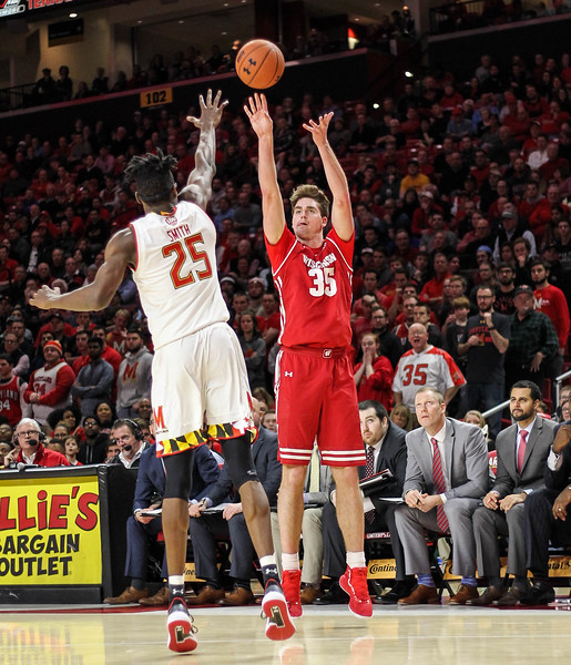 January 14, 2019: Wisconsin forward Nate Reuvers (35) shoots a three over Maryland forward Jalen Smith (25) during BIG Ten Men Basketball action between University of Wisconsin and University of Maryland in College Park. Photo by: Chris Thompkins/Prince Georges Sentinel