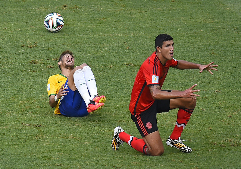 . Brazil\'s forward Neymar (L) reacts after falling next to Mexico\'s defender Francisco Rodriguez during a Group A football match between Brazil and Mexico in the Castelao Stadium in Fortaleza during the 2014 FIFA World Cup on June 17, 2014.  (FABRICE COFFRINI/AFP/Getty Images)