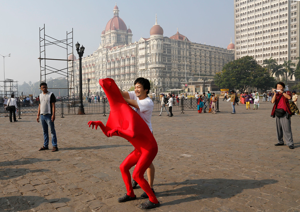 . Members of the 3Gaga Heads, a 3-member comedy group from Japan, rehearse at the promenade outside the Taj Mahal Hotel, one of the sites of the Mumbai terror attack, during the 5th anniversary of the attack in Mumbai, India, Saturday, Nov. 26, 2013. The attack by Pakistani gunmen in India\'s financial capital on Nov. 26, 2008 killed 166 people and shattered relations between the nuclear-armed neighbors.  (AP Photo/Rajanish Kakade)