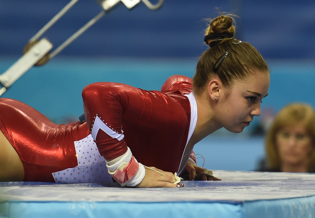 . Switzerland\'s Laura Schulte gets up after a fall while competing on the uneven bars during the women\'s qualification at the Gymnastics World Championships in Nanning, in China\'s southern Guangxi province on October 5, 2014. GREG BAKER/AFP/Getty Images