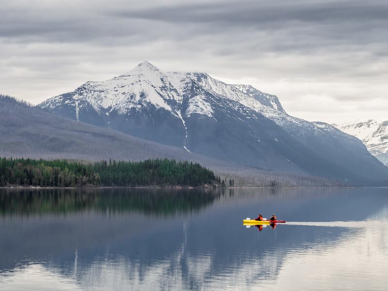 Couple Kayaking in Lake McDonald in Glacier National Park in Early Spring