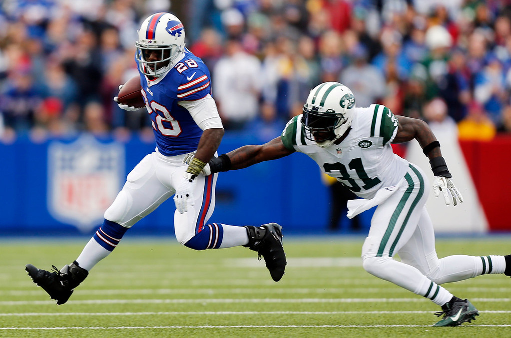 . Buffalo Bills running back C.J. Spiller (28) eludes New York Jets cornerback Antonio Cromartie (31) during the first half of an NFL football game on Sunday, Nov. 17, 2013, in Orchard Park, N.Y. (AP Photo/Gary Wiepert)