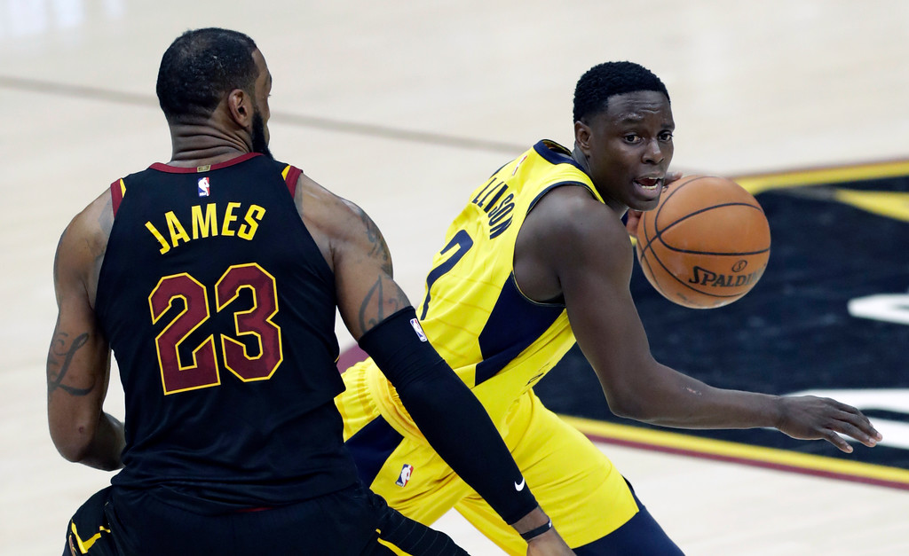 . Indiana Pacers\' Darren Collison, right, drives around Cleveland Cavaliers\' LeBron James in the second half of Game 5 of an NBA basketball first-round playoff series, Wednesday, April 25, 2018, in Cleveland. The Cavaliers won 98-95. (AP Photo/Tony Dejak)