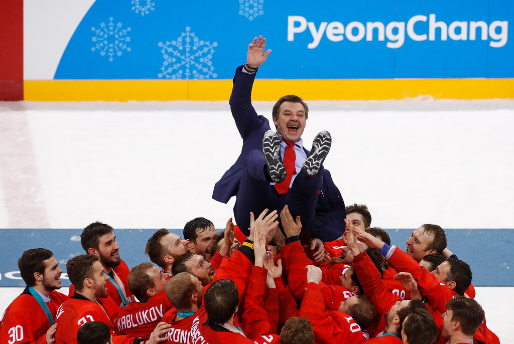 . Olympic athletes from Russia celebrate with their coach Oleg Znarok after winning the men\'s gold medal hockey game against Germany, 4-3, in overtime at the 2018 Winter Olympics, Sunday, Feb. 25, 2018, in Gangneung, South Korea. (AP Photo/Jae C. Hong)