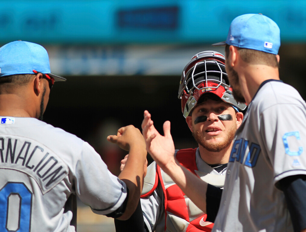 . Cleveland Indians Edwin Encarnacion (10), Roberto Perez (55) and Andrew Miller celebrate after defeating the Minnesota Twins in a baseball game Sunday, June 18, 2017, in Minneapolis. (AP Photo/Andy Clayton-King)