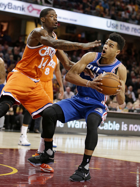 . Philadelphia 76ers\' Timothe Luwawu-Cabarrot (20), from France, drives against Cleveland Cavaliers\' DeAndre Liggins (14) in the second half of an NBA basketball game, Friday, March 31, 2017, in Cleveland. (AP Photo/Tony Dejak)