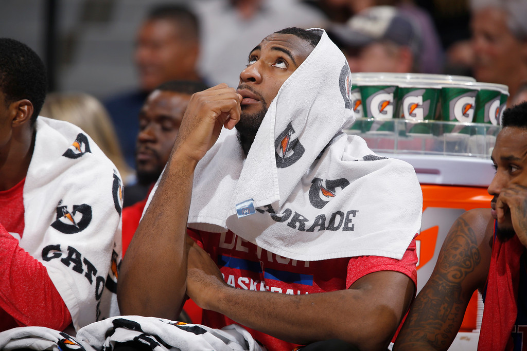 . Detroit Pistons center Andre Drummond checks the overhead scoreboard while sitting on the bench against the Denver Nuggets in the third quarter of the Nuggets\' 89-79 victory in an NBA basketball game in Denver on Wednesday, Oct. 29, 2014. (AP Photo/David Zalubowski)