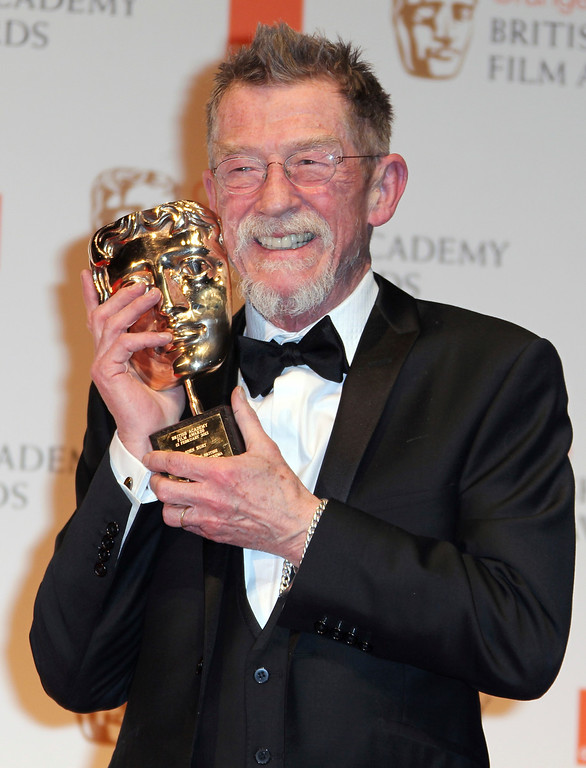 """. Sir John Hurt posing with his award for \""""Outstanding Contribution to Cinema\"""" backstage at the BAFTA Film Awards 2012, at The Royal Opera House in London. The great and versatile actor Hurt, who could move audiences to tears in �The Elephant Man,� terrify them in �Alien,� and spoof that very same scene in �Spaceballs,� has died at age 77.  Hurt, who battled pancreatic cancer, passed away Friday, Jan. 27, 2017, in London according to his agent Charles McDonald. (AP Photo/Joel Ryan, File)"""