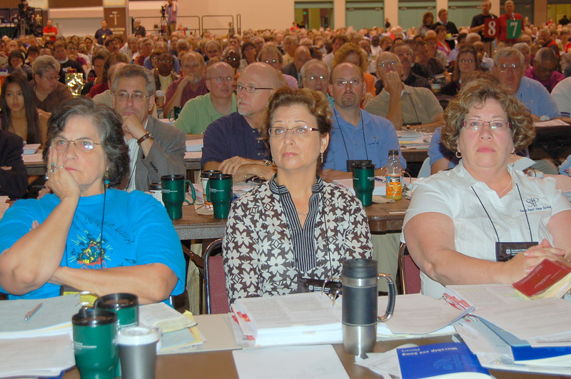 The newly ordained Rev. Jennie Lightfoot (left) listens during plenary session eight during the 2009 Churchwide Assembly.  Lightfoot was ordained Aug. 13 in Minneapolis.
