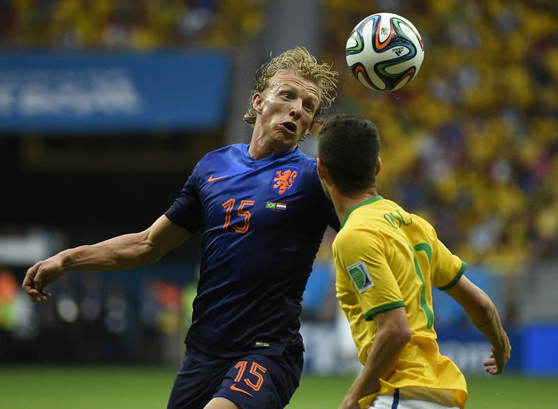 . Netherlands\' defender Dirk Kuyt (L) and Brazil\'s midfielder Oscar vie during the third place play-off football match between Brazil and Netherlands during the 2014 FIFA World Cup at the National Stadium in Brasilia on July 12, 2014. (ODD ANDERSEN/AFP/Getty Images)