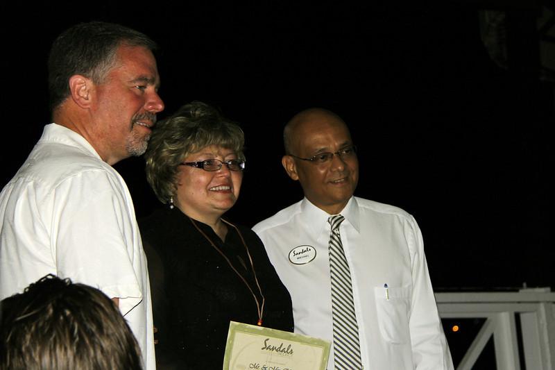 "Jim & Debbie receiving their ""Free Week"" certificate with General Manager Michael Jame"
