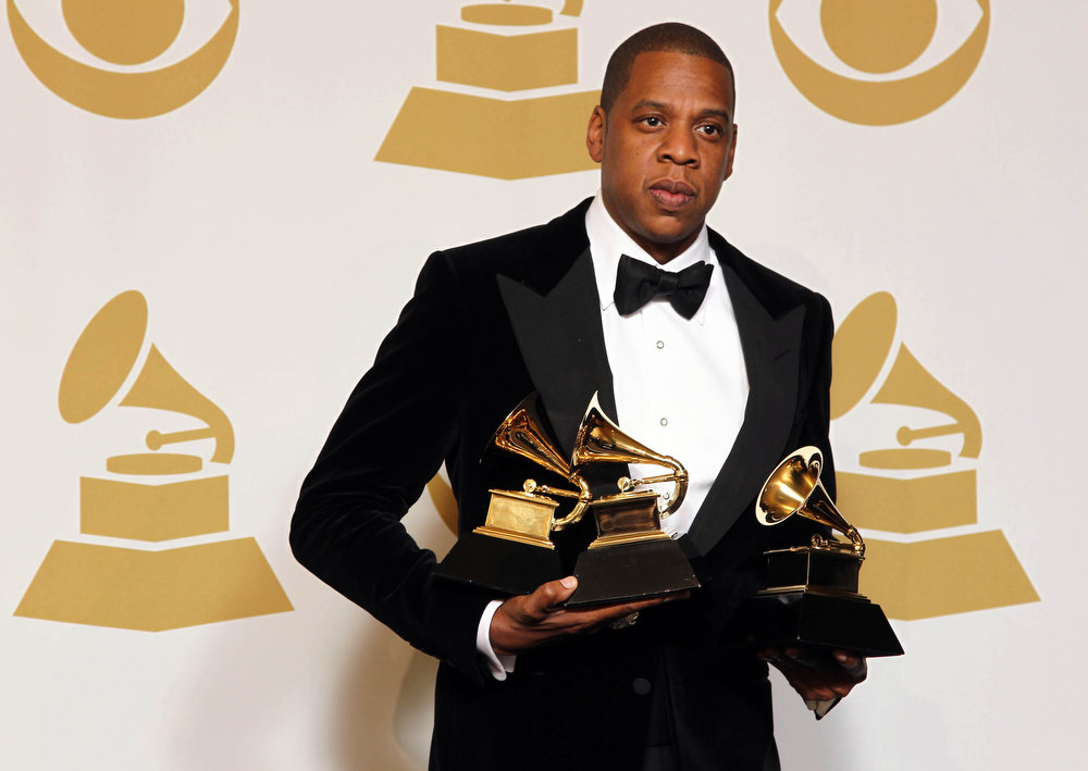 Description of . Jay-Z poses backstage with the awards for best rap/sung collaboration for