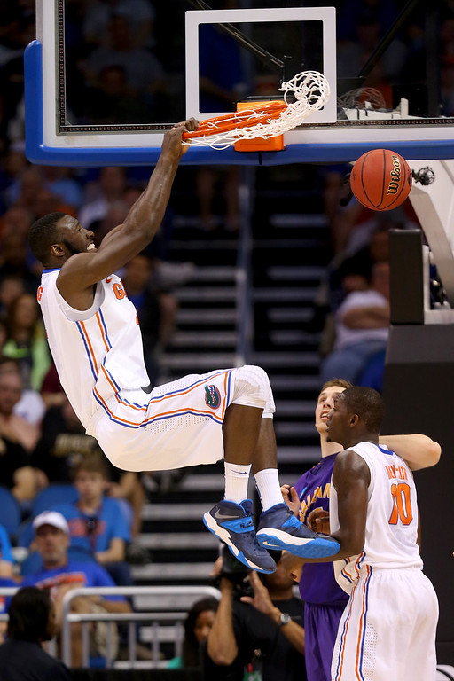 . ORLANDO, FL - MARCH 20:  Patric Young #4 of the Florida Gators dunks the ball in the first half while taking on the Albany Great Danes during the second round of the 2014 NCAA Men\'s Basketball Tournament at Amway Center on March 20, 2014 in Orlando, Florida.  (Photo by Mike Ehrmann/Getty Images)