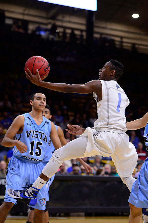 . Nieyeme Smyer-williams (1) of Pueblo West goes for a lay up after being fouled during the fourth quarter at the Coors Events Center on March 11, 2016 in Boulder, Colorado. Pueblo West defeated Vista Ridge 65-54 to advance to the 4A finals of Colorado state basketball tournament.  (Photo by Brent Lewis/The Denver Post)