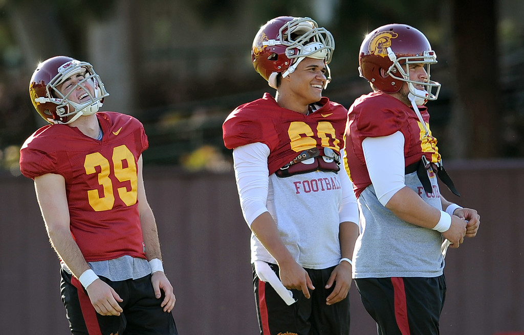 . USC players enjoy a laugh during spring practice at USC Monday, April 1, 2014. (Andy Holzman/Los Angeles Daily News)