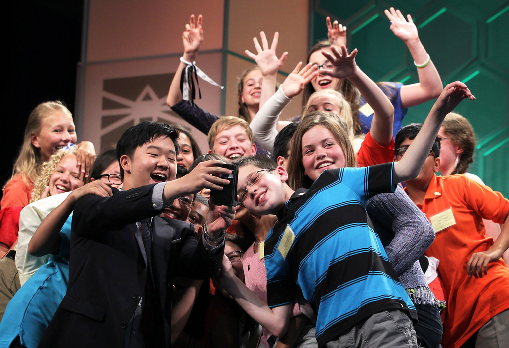 ". Spellers who have been eliminated from the competition take a selfie, also known as ""spellfie,\"" during a live broadcast commercial break of final rounds of the 2014 Scripps National Spelling Bee May 29, 2014 in National Harbor, Maryland. Hathwar and Sujoe were declared as co-champions after 22 rounds of the competition.  (Photo by Alex Wong/Getty Images)"