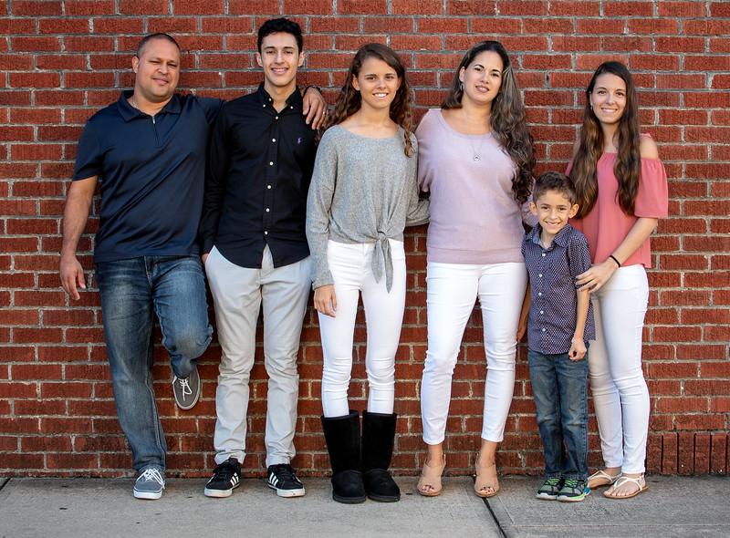 Prada family by wall cropped.jpg
