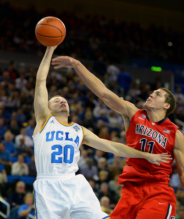. UCLA\'s Bryce Alford is fouled while shooting against Arizona\'s Aaron Gordon in the first half, Thursday, January 9, 2014, at Pauley Pavilion. (Photo by Michael Owen Baker/L.A. Daily News)