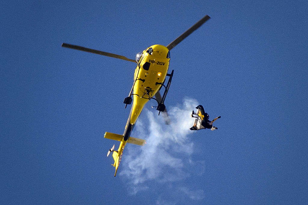 ". Swiss pilot Yves Rossy known as the ""Jetman\"" jumps from a helicopter with his jet-powered two meters wingspan wing attached to his back during the first day of AIR14 air show on August 30, 2014 in Payerne, western Switzerland. AFP PHOTO / FABRICE COFFRINI/AFP/Getty Images"