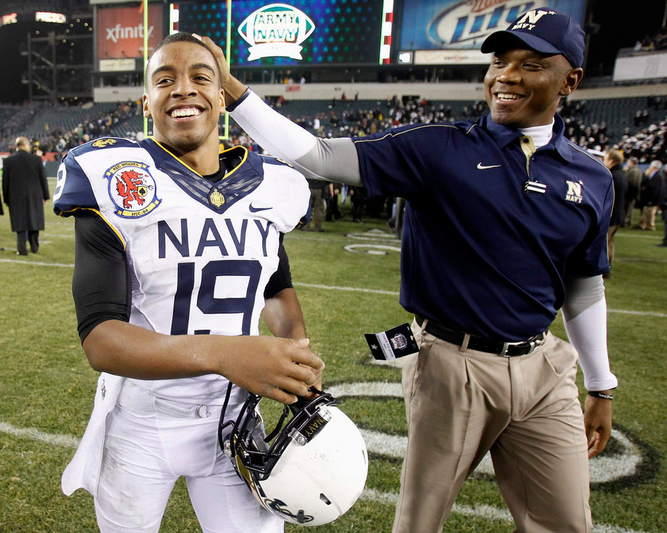 . Navy quarterback Keenan Reynolds (19) is congratulated by Navy coach Ivan Jasper on a win over Army at the conclusion of the Army versus Navy NCAA football game in Philadelphia, Pennsylvania, December 8, 2012. REUTERS/Tim Shaffer