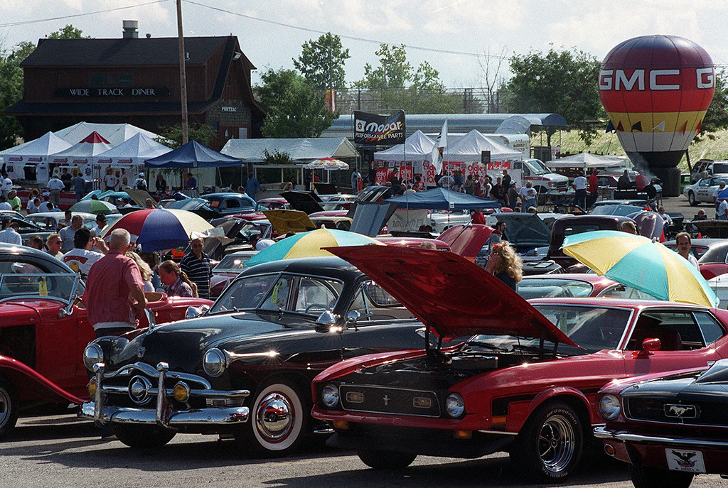 . Classic cars fill the parking lot of the Phoenix Plaza during Friday night\'s kick-off of this year\'s Woodward Ave. Dreram Cruise in Pontiac.