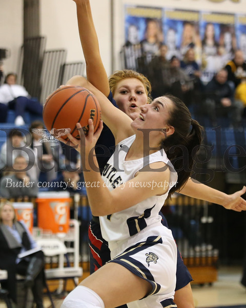 Butler junior Alison Altman (21) drives past Shaler's Claire Grunden in Monday night's 49-42 win at home. Seb Foltz/Butler Eagle